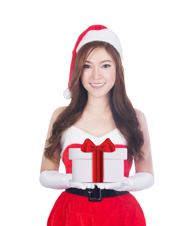 Christmas woman holding christmas gifts smiling. Cute beautiful Caucasian santa girl isolated on white background