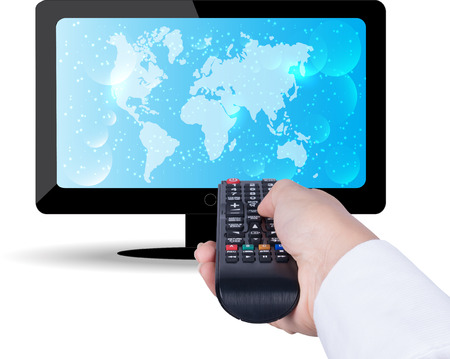 Watching TV and using remote controller. Holding TV remote control Banque d'images