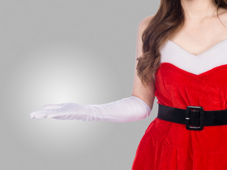 young christmas girl holding something on gray background