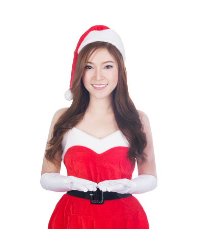 Christmas woman holding Something smiling. Cute beautiful Caucasian santa girl isolated on white background