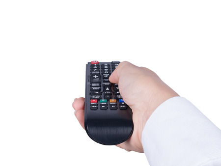 Hand with remote control pointing forward isolated at white Banque d'images