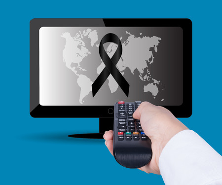 Watching TV and using remote controller. Holding TV remote control Banco de Imagens