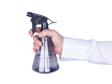 Hand holding plastic foggy spray bottle isolated on white background