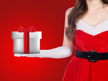 Santa girl holding christmas gift on red background, christmas holiday concept