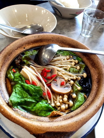 Bak kut teh Chinese style : a pork rib dish cooked mixed vegetable in broth popularly