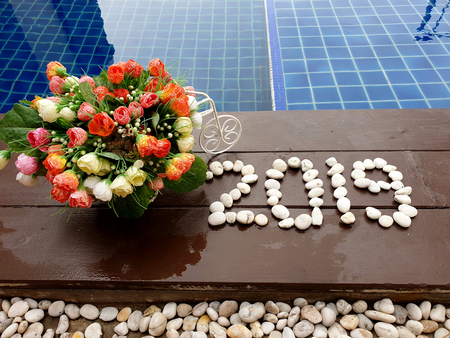 New year 2019 written with stones on wooden background close up swimming pool