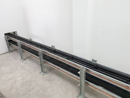 Cable tray installation in electrical substation.