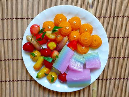 Colorful sweet Thai desserts, Deletable Imitation Fruits (Khanom Look Choup), Thai layer dessert (Khanom chan), Wheat Flour Dumplings with Egg Yolks (Khanom Thong ek).