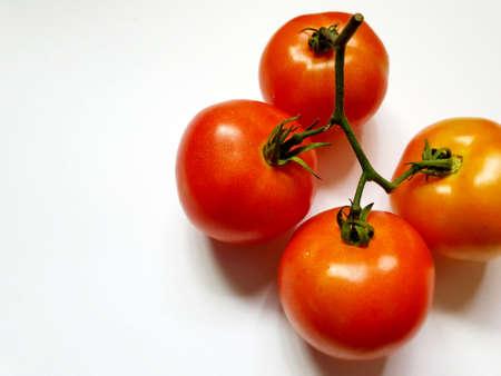 Fresh tomato on white background.