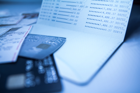 deposit slip: Balance of savings deposit passbook, sale slip and credit card, Blue toned, shallow DOF