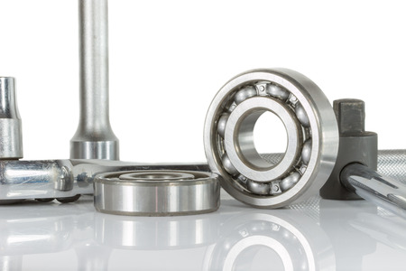 ball bearing with drive socket set on white, and reflections Stock Photo