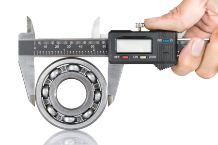Metal vernier caliper and Ball bearings on white background Stock Photo - 25518411