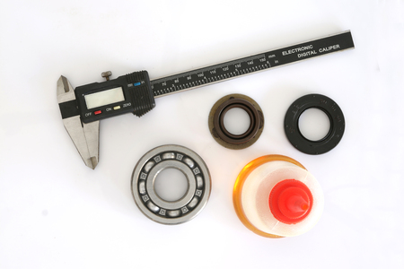 Vernier, bearing, Oil Seal and Oil on white background photo