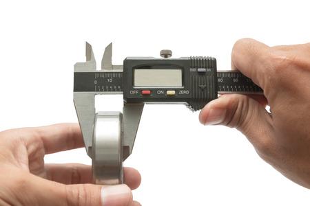 Man using vernier caliper Measurements of the Bearing, on white background photo