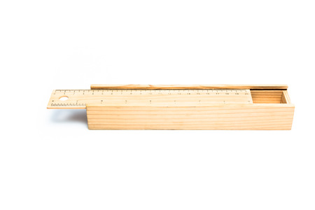 Wooden pencil box and ruler two in one isolated on white background photo