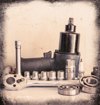 minutiae: Pneumatic wrench, drive socket set, ball bearing, on over white, Vintage style Stock Photo