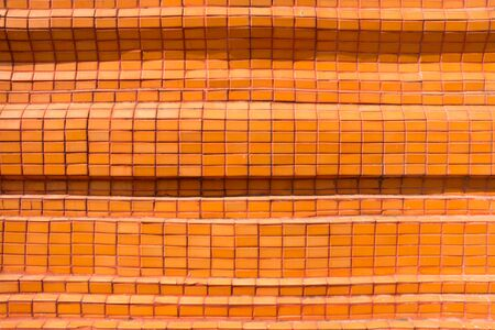 tiled wall: Orange tiled wall for background Stock Photo