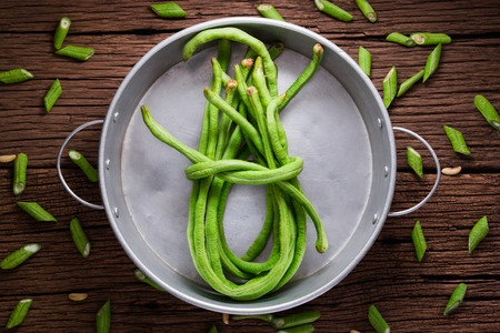 Cowpea or Yardlong bean on wood background photo