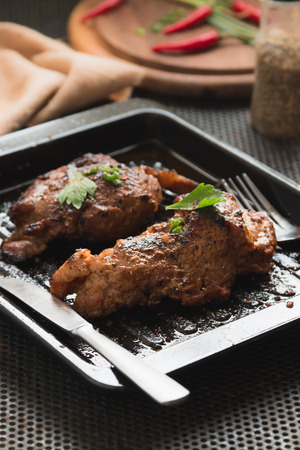 Pork steak seasoned with pepper, salt, spices, herbs crushed, with cayenne pepper for good health.
