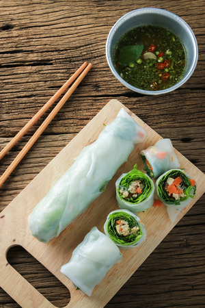 Fresh Spring Rolls with vegetables and pork on old wooden table