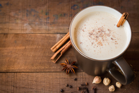 glass of milk: masala chai with spices. Cinnamon Stick, Thai Cardamom, Ginger, Clove, Star Anise, Black Peppercorns, Fennel Seeds, Black Tea