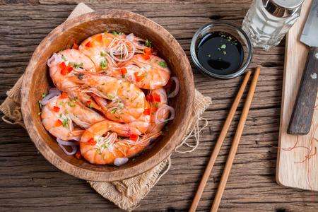 prepared shrimp: Steamed shrimps in a wooden bowl on wood