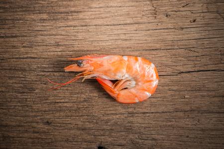 shrimp cocktail: steamed shrimps on wood background Stock Photo