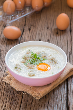 chinese meal: congee, rice gruel Khao Tom Moo mixed with pork and eggs