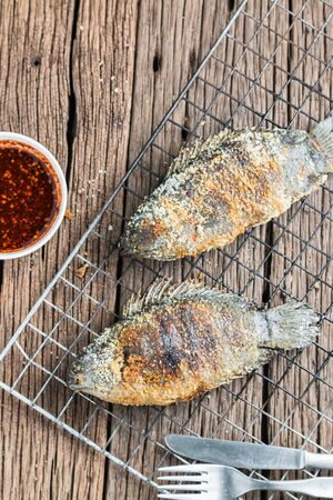 traditional climbing: Fresh Climbing perch or Climbing gourami grilled with salt, Traditional Thai food
