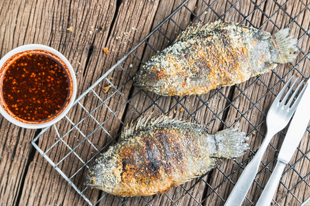 food fish: Fresh Climbing perch or Climbing gourami grilled with salt, Traditional Thai food