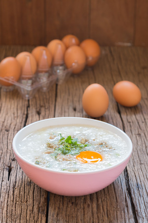congee, rice gruel Khao Tom Moo mixed with pork and eggs