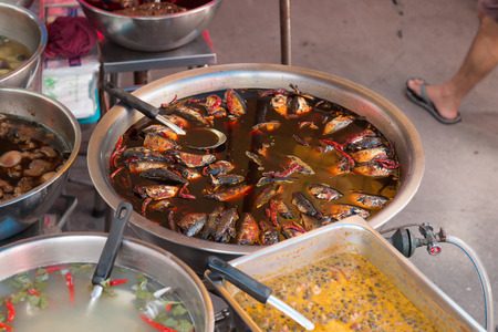 salty: STEWED MACKEREL FISH IN SALTY SOUP Street food of thailand Stock Photo