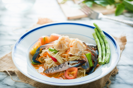 somtum: Thai food papaya salad with pickled Blue crab Somtum Stock Photo