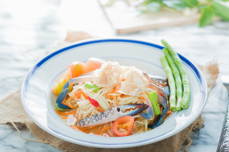 blue crab: Thai food papaya salad with pickled Blue crab Somtum Stock Photo