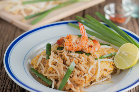 close-up Thai Fried Noodles Pad Thai with shrimp and vegetables