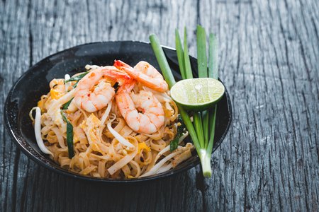 thai pepper: Thai Fried Noodles Pad Thai with shrimp and vegetables Stock Photo