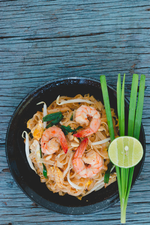 thai noodle: Thai Fried Noodles Pad Thai with shrimp and vegetables Stock Photo