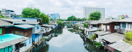underprivileged: Poor house And the dirty water canal in suburb Thailand. panorama