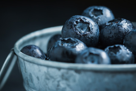 c vitamin: Blueberry in Small tank on wooden background Stock Photo