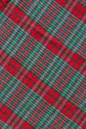 checkered polo shirt: red plaid fabric clearly texture background