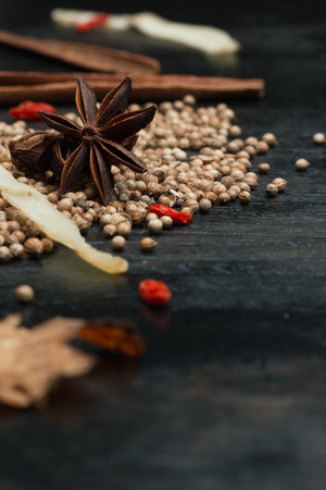 variability: Macro closeup Spices and herbs on black wood background
