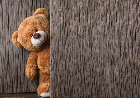 Cute teddy bears on old wood background with copy space