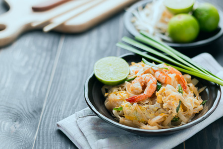Thai food background Thai Fried Noodles Pad Thai with shrimp and vegetables. Thailands national dishes