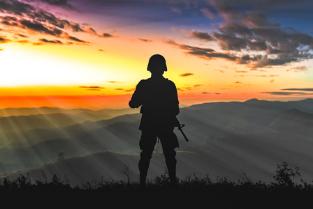 Army rangers on the sunrise in the mountains