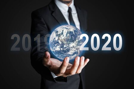 Future business world concept with businessman and Earth. Stock Photo