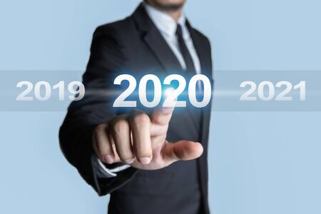 Businessmen are choose to touching the year 2020. Concept of targeting for success.