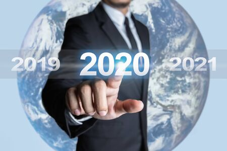 Businessmen are touching the year 2020 and are in transition of the times in the business world. Concept of targeting for success.