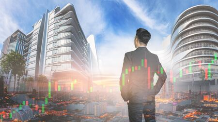 Asian businessmen in the city with morning light and Stock graph, Investor concept. Stock Photo