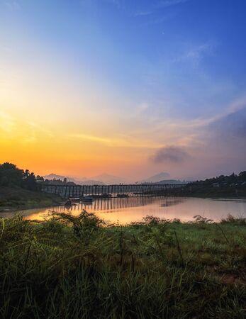 Sunset The old wooden bridge (MON BRIDGE) longest in Thailand. at Sangklaburi in Kanchanaburi, Thailand