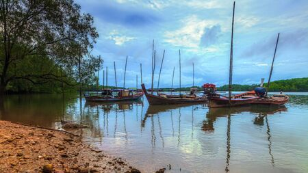Landscapes Fishing boat parked in the mangrove forest near the fishing village Stock Photo
